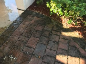 Before pressure cleaning shot of dirty pavers